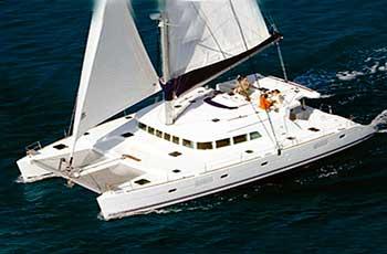Renta de catamaran en cancun, paseo de snorkel a Isla Mujeres, barra libre, pago por persona, charter privado desde cancun Lagoon 500